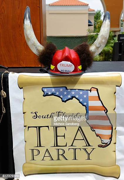 Close up of South Florida Tea Party banner at the group's Tax Day event Boca Raton Florida April 16 2011 Above it is a hard hat decorated with horns...