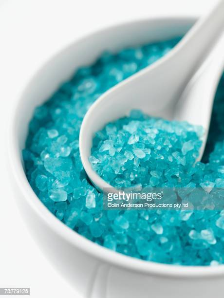 Close up of spa bath salts in bowl with spoon
