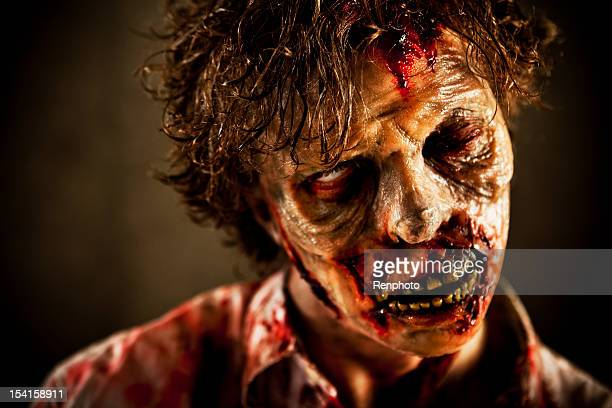 close up of special effects zombie face and makeup - zombie makeup stock photos and pictures