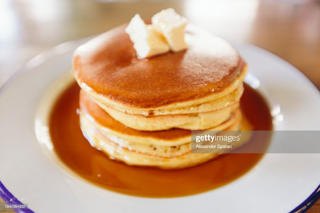 Close up of stack of American pancakes with butter and maple syrup : Stock Photo