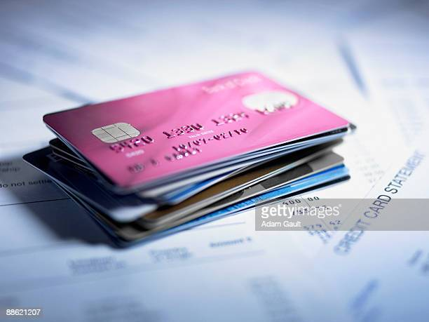 close up of stack of credit cards - charging stock pictures, royalty-free photos & images