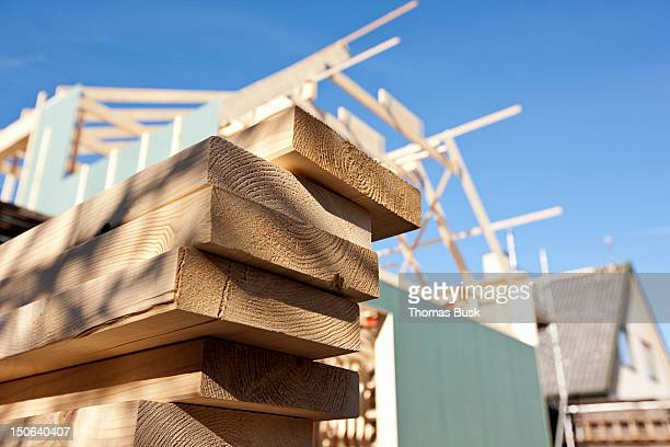 Close up of stacked wood on site