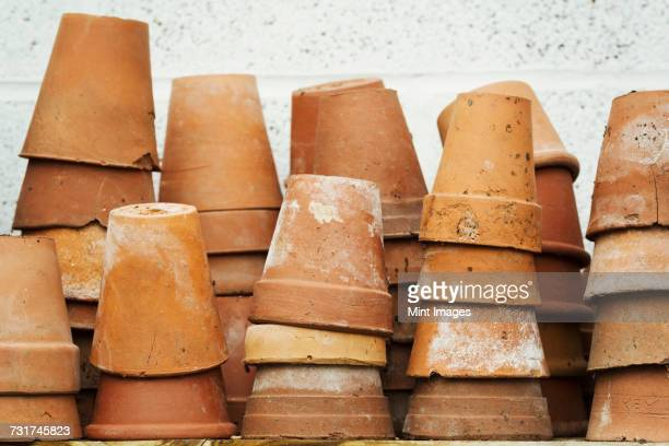 close up of stacks of terracotta plant pots. - terracotta stock pictures, royalty-free photos & images