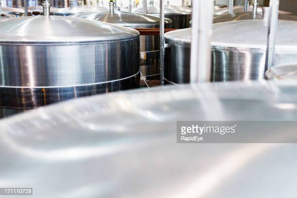 Close up of stainless steel fermentation vats at modern winery
