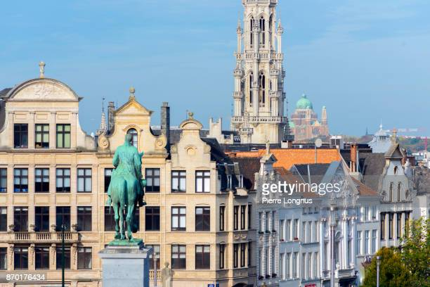 Close up of Statue of King Albert the 1st looking towards the tower of the Brussels Town Hall - Brussels, Belgium