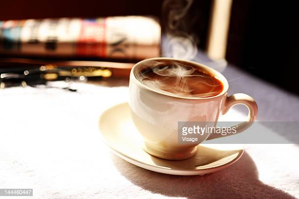 Close up of steaming coffee cup