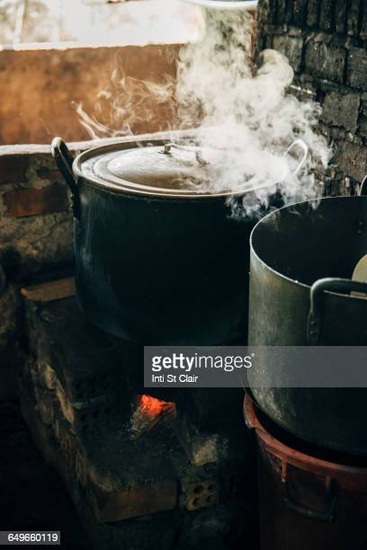 Close up of steamy pot cooking on stove