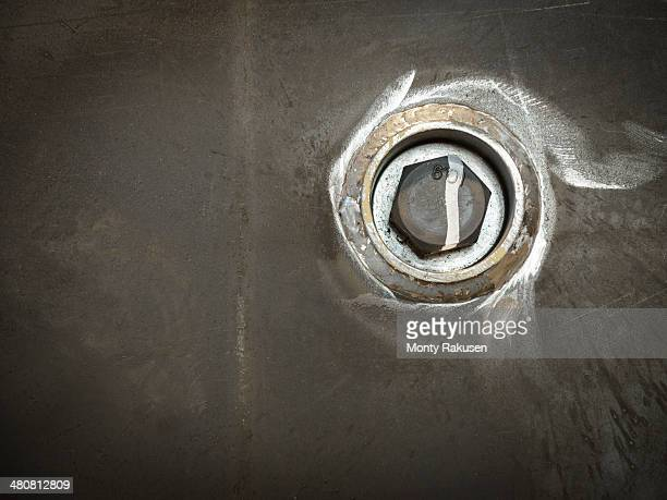 close up of steel nut in factory - monty rakusen stock pictures, royalty-free photos & images
