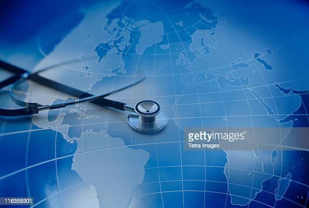 Close up of stethoscope with world map in background