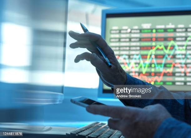 close up of stock market trader analysing share price data on the screen. - ハイウィッカム ストックフォトと画像