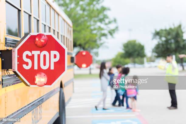 close up of stop sign on school bus - disembarking stock pictures, royalty-free photos & images
