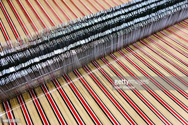 Close up of striped textile on weaving machine in woollen mill