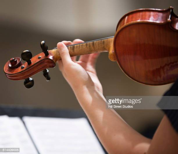 Close up of student playing violin