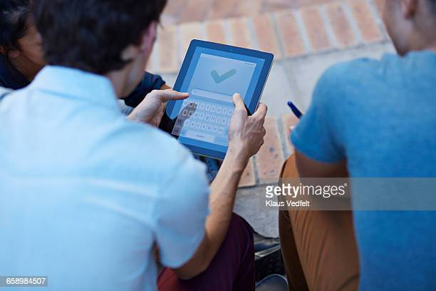 close- up of students using digital tablet - convenience stock photos and pictures