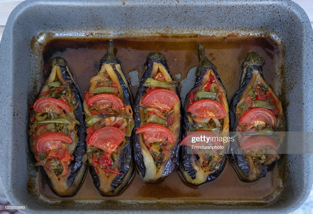 Close up of stuffed eggplants in a pan cooked in the oven. : Stock Photo