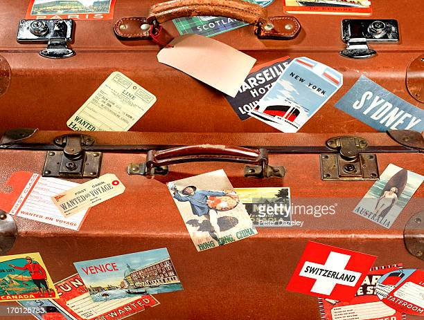 Close up of suitcase with travel stickers