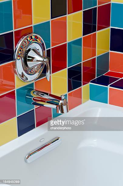 Close up of sunken tub with colorful tile