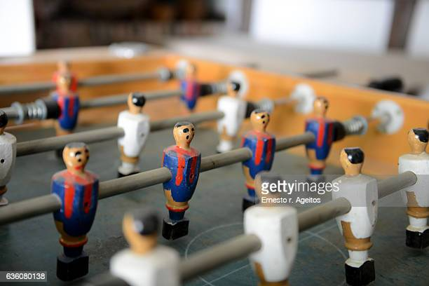 Close up of table soccer with wooden players