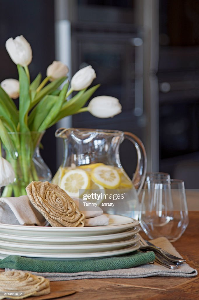 Close up of table with bouquet and jar : Photo