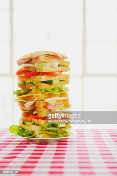 Close up of tall sandwich on table