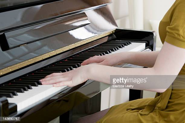 close up of teenage girl playing piano - constantia foto e immagini stock