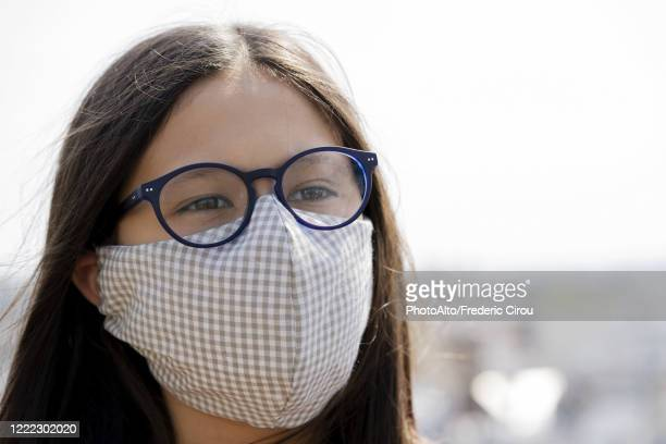 close up of teenage girl wearing homemade face mask outdoors - spectacles stock pictures, royalty-free photos & images