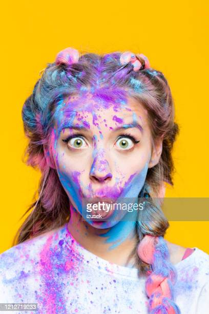 close up of teenage girl's face coverd in color powder - izusek stock pictures, royalty-free photos & images