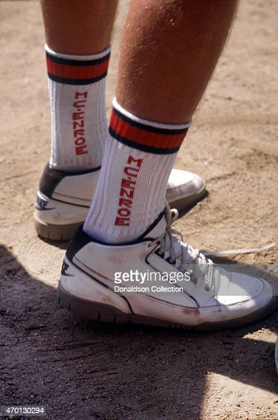 A close up of tennis star John McEnroe and his eponymous socks and Nike tennis shoes during an exhibition match for Cerebral Palsy Research at the...