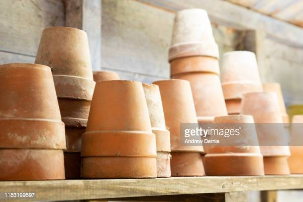 close up of terracotta plant pots - andrew dernie stock pictures, royalty-free photos & images