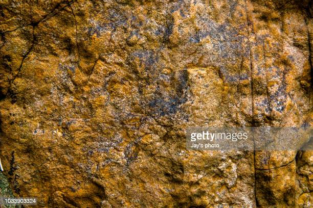 a close up of texture on natural slate. background - granite stock pictures, royalty-free photos & images