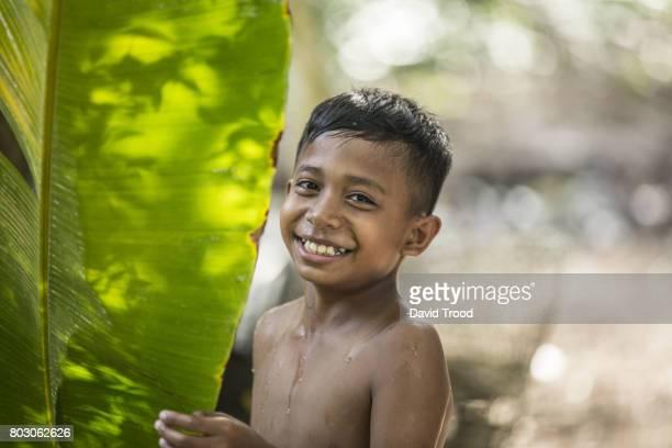 Close up of Thai boy smiling