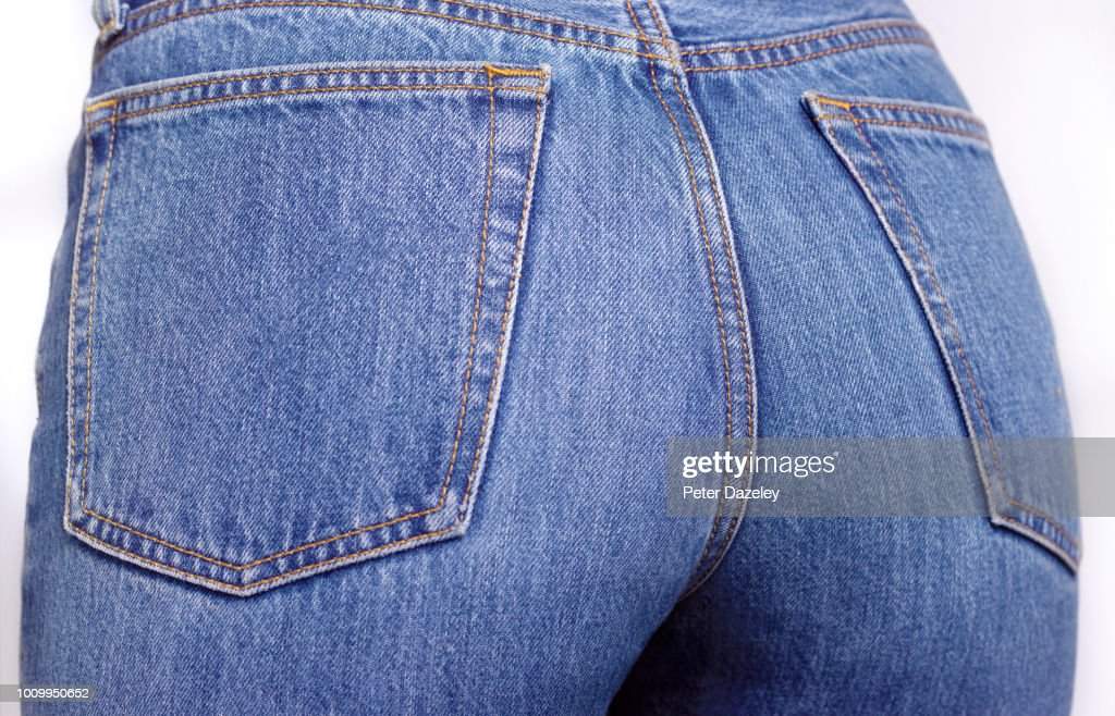 Close up of the bottom of a woman wearing denim jeans : Stock Photo