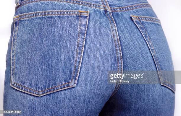 close up of the bottom of a woman wearing denim jeans - woman bum stock pictures, royalty-free photos & images
