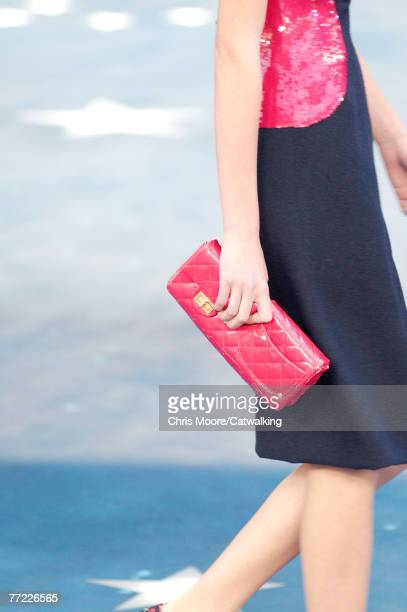 Close up of the clutch purse carried by a model walking the runway at the Chanel Spring Summer 2008 show part of Paris Fashion Week 2007 at the Grand...