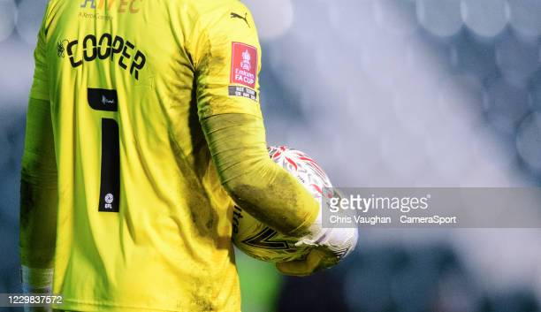 Close up of the Emirates FA Cup sleeve badge on the shirt worn by Plymouth Argyle's Michael Cooper during the The Emirates FA Cup Second Round match...
