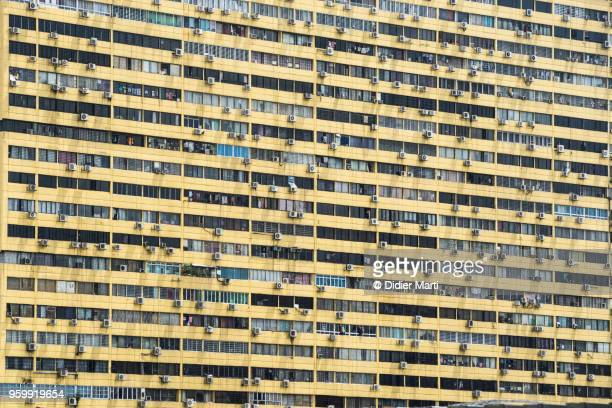 Close up of the facade of a large residential apartment block in Singapore