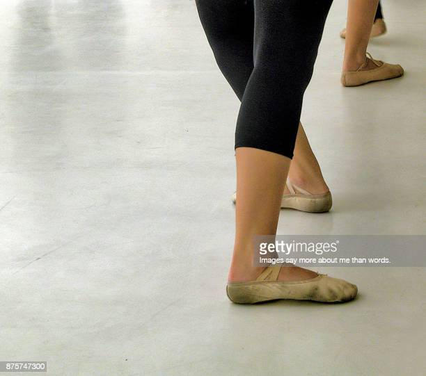 close up of the feet of rehearsing ballerinas. - images of ugly feet stock photos and pictures