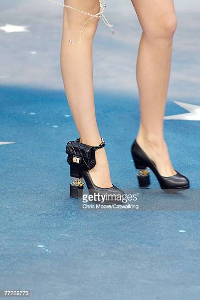 A close up of the footwear worn by a model walking the runway at the Chanel Spring Summer 2008 show part of Paris Fashion Week 2007 at the Grand...