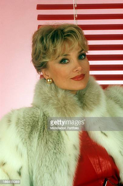 Close up of the German actress Barbara Bouchet born Gutscher and naturalized Italian into a photo studio wearing a white fur coat after a long career...