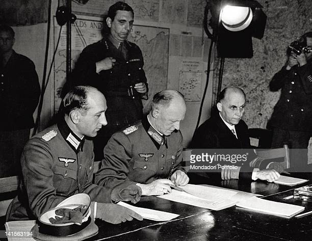 Close up of the German plenipotentiary chiefs while they are reading the surrender terms in the room of the 'red school' of Reims From the left...