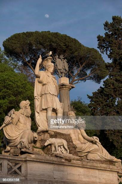 close up of the goddess of rome statue with a seagull on her hear and moon above,rome. - emreturanphoto stock-fotos und bilder