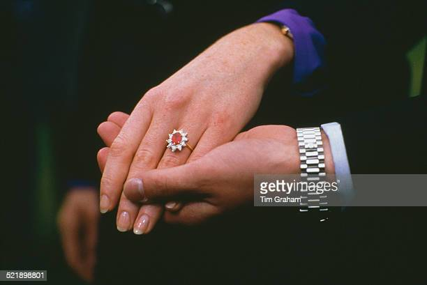 Close up of the hands of Prince Andrew and Sarah Ferguson after the announcement of their engagement at Buckingham Palace, London, 17th March 1986....