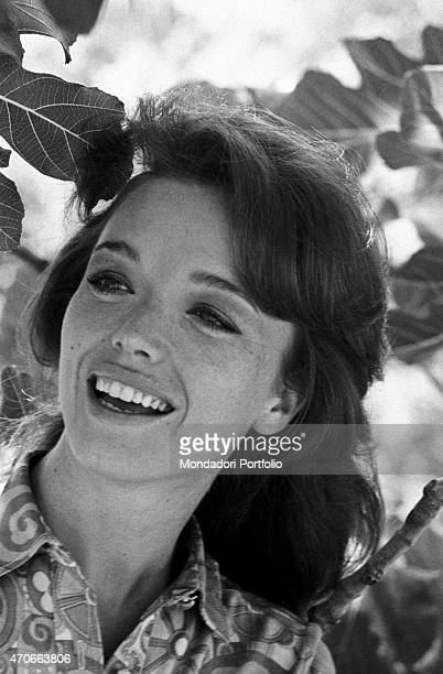 'Close up of the Italian TV announcer Aba Cercato laughing happily in a garden before a fig tree she's considered the best RAI announcer speaks four...
