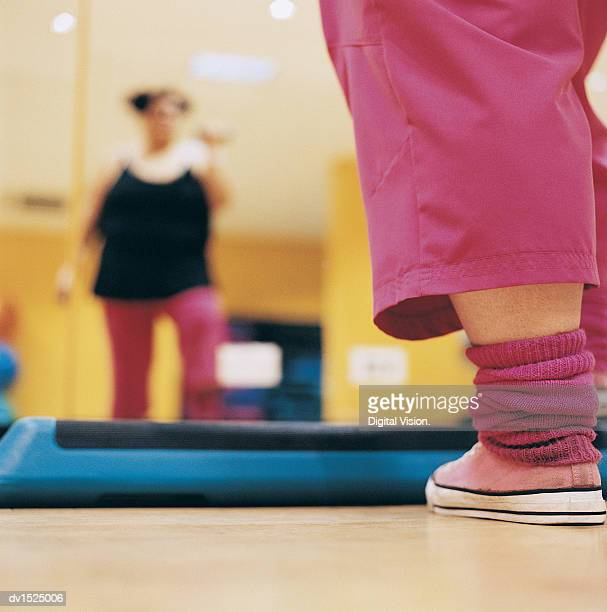 Close Up of the Leg of an Overweight Woman Doing Aerobics