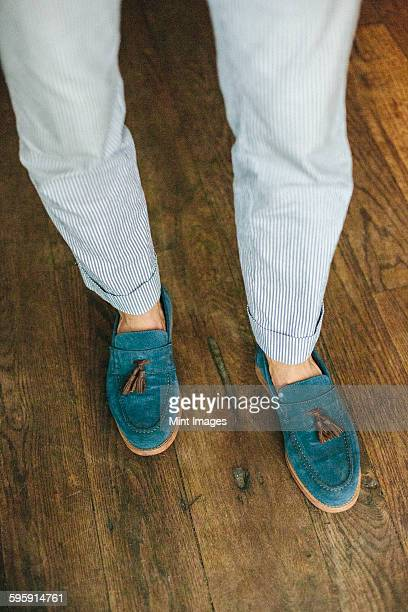 close up of the legs and feet of a staff member at a city restaurant. - loafer stock pictures, royalty-free photos & images