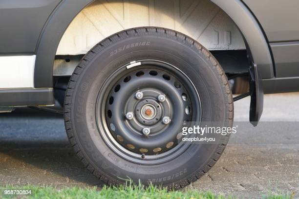 close up of the new tire on a parked delivery truck (without hubcap) - hub stock pictures, royalty-free photos & images