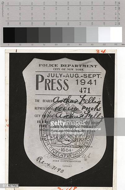 Close up of the press badge of American photographer Weegee issued by the New York Police Department 1941 Photo by Weegee/International Center of...