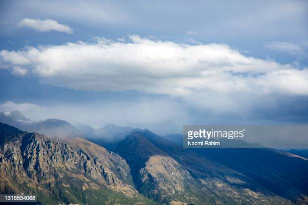 close up of the remarkables mountain peaks in queenstown, new zealand - wilderness stock pictures, royalty-free photos & images