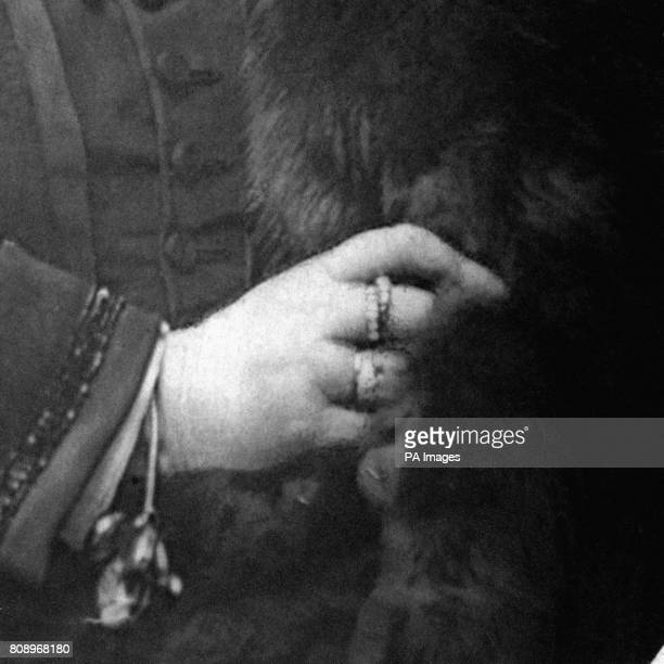 A close up of the right hand of Queen Victoria showing the Emerald Snake Ring which was her engagement ring from Prince Albert of SaxeCoburg and Gotha