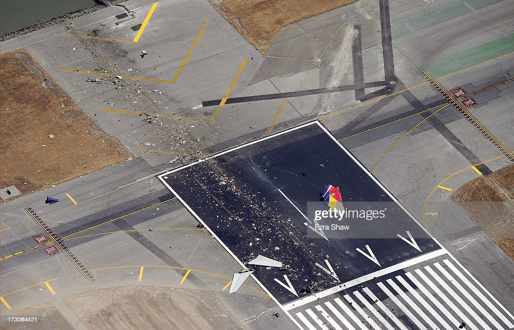 A close up of the runway and debris of a Boeing 777 airplane that burned on the runway after it crash landed at San Francisco International Airport July 6, 2013 in San Francisco, California. An Asiana Airlines passenger aircraft coming from Seoul, South Korea crashed while landing. There has been at least two casualties reported.